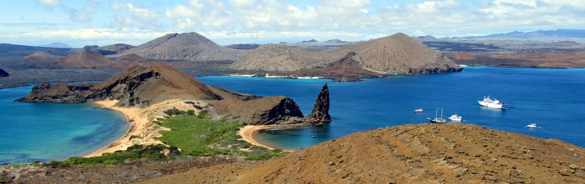 The iconic view of the Galapagos Islands. Pinnacle Rock as seen from the observation peak on St. Bartolome.